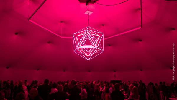 VITRA party tent is illuminated by a giant chandelier made up of LIGEO lights in RGB-W colors.